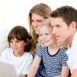 Smiling family surfing on internet — Stock Photo
