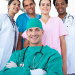International medical team with a confident surgeon in the foreg — Stock Photo