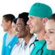 Multi-ethnic medical group standing in a line — Stock Photo