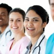 A diverse medical group standing in a line — Stock Photo