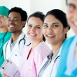 Smiling medical team in a line — Stock Photo #10317750