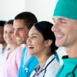 Stock Photo: Happy international medical team in a row