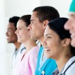 Multi-ethnic medical team standing in a line — Stock Photo #10317784