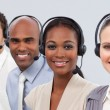 International business with headset on in a line — Stockfoto