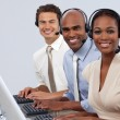 Foto Stock: Enthusiastic business partners with headset on