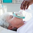 A doctor putting oxygen mask on a patient — Stock Photo #10317802
