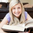 Smiling woman reading a book — Stock Photo