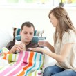 Positive woman taking care of her husband — Stock Photo