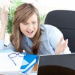 Angry businesswoman looking at the laptop — Stock Photo