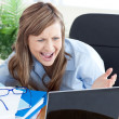 Stock Photo: Astonished businesswoman looking at the laptop