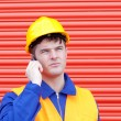 Attractive male engineer talking on the phone — Stock Photo
