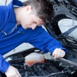 Self-assured man repairing a car — Stock Photo