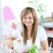 Stock Photo: Young wompreparing salad in kitchen
