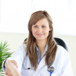 Attractive female doctor shaking a hand — Stock Photo