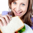 Beautiful woman holding a sandwich — Stock Photo