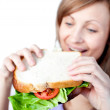 Caucasian woman holding a sandwich — Stock Photo