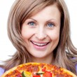 Happy woman holding a pizza - ストック写真