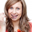 Charming woman eating a cake — Stock Photo