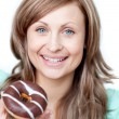 Delighted woman eating a cake — Stock Photo