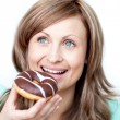 Hungry woman eating a cake — Stock Photo