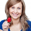 Beautiful woman eating strawberries — Stock fotografie