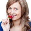 Radiant woman eating strawberries — Foto Stock