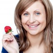 Delighted woman eating strawberries — Stock Photo