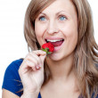 Bright woman eating strawberries — Stock Photo