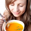 Foto Stock: Delighted womholding soup bowl