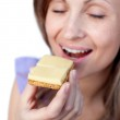 Young woman eating a cracker with cheese — Stock Photo #10319545