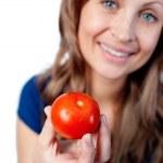 Smiling woman holding a tomato — Stock Photo #10319556