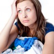 Upset woman doing laundry — Stock Photo #10319565