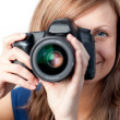 Smiling woman using a camera - Stock Photo