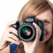 Attractive woman using a camera — Stock Photo
