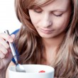 Beautiful woman eating cereals — Stock Photo