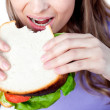 Close-up of a woman eating a sandwich — Stock Photo