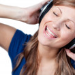 Royalty-Free Stock Photo: Cute woman listening music with headphone