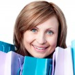 Smiling woman showing her shopping bags - Foto Stock