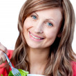 Delighted woman is eating a salad — Stock Photo