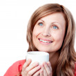 Smiling woman drinking a cup of coffee — Stock Photo #10319726