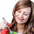 Cute woman is eating a salad — Stock Photo #10319739