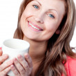 Cute woman drinking a cup of tea — Stock Photo #10319754