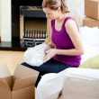 Caucasian woman having a break between boxes — Stock Photo