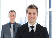 Senior and Junior business looking at the camera — Stock Photo