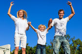 Happy family Jumping in the air — Stock Photo