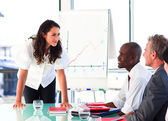 Businesswoman interacting with her colleagues after a presentati — Stock Photo