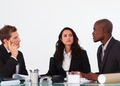 Three business interacting in a meeting — Stock Photo