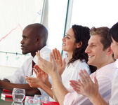 Business team clapping in a meeting — Stock Photo