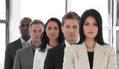 Grupo étnico multi mirando a cámara — Foto de Stock