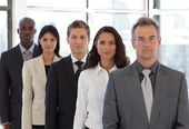 Young positive Business team looking at camera — Stock Photo